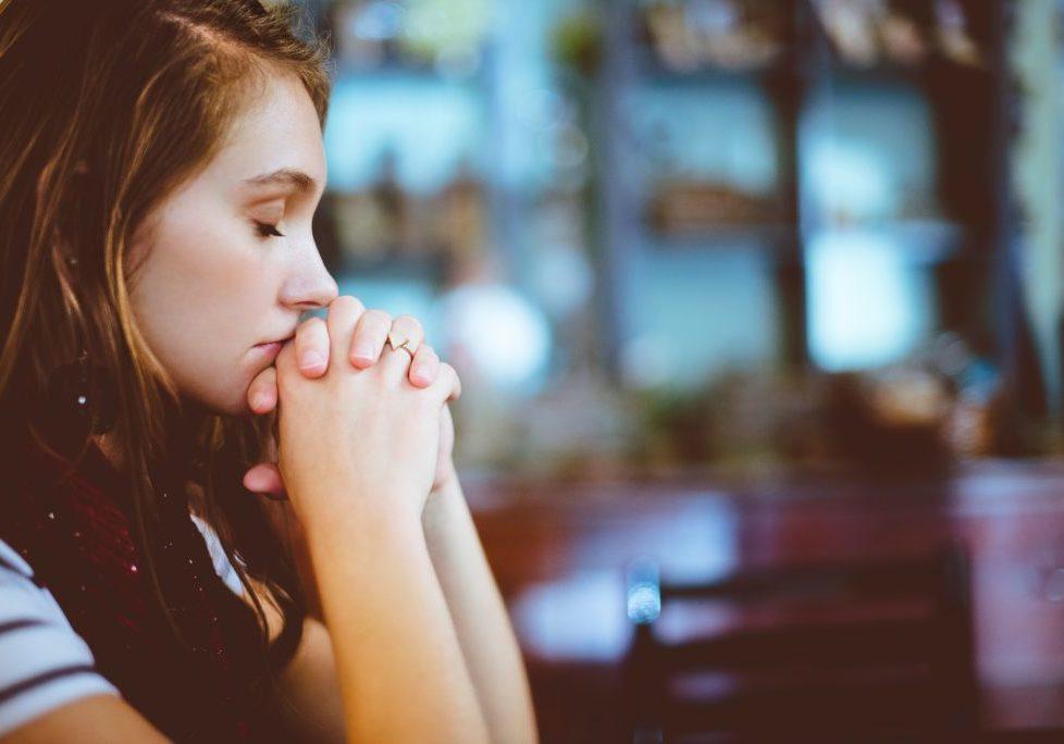 woman kneeling praying